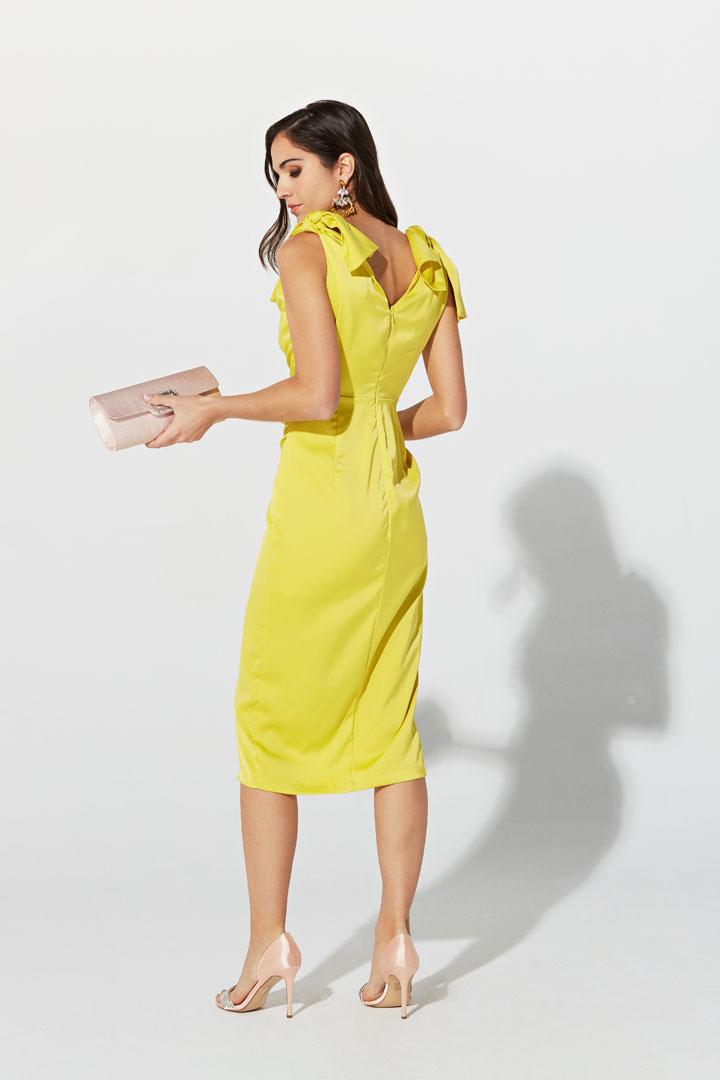 Vestido amarillo de lazos